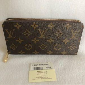 Authentic Louis Vuitton Zip Wallet